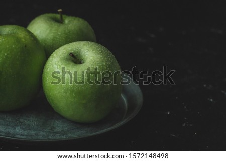 Fresh granny smith apples, front view. Vertical image. Food concept