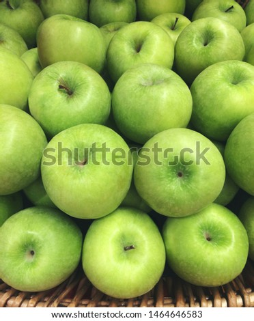 fresh granny smith or golden delicious green apples in basket at super market. Green apple texture. raw Food Fruit healthy concept