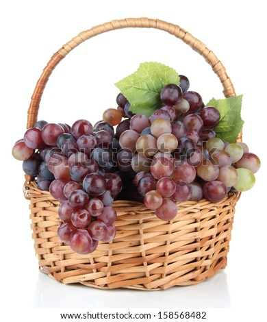 Fresh grape in wicker basket, isolated on white