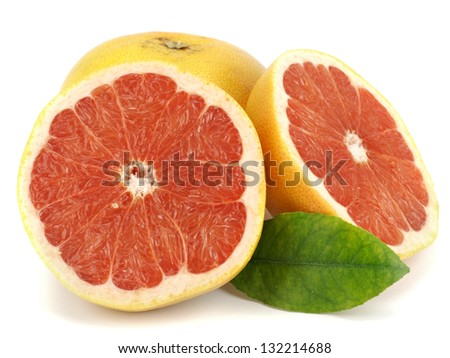 Fresh grapefruits with leaf on white background