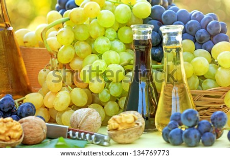 Fresh grapes and wine on the table