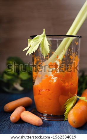 fresh grated carrots in a measuring cup with celery, healthy food, vegetarian food