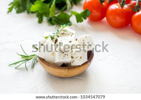 Fresh Greek Feta Cheese. Healthy ingredient for cooking salad. Chopped Goat feta cheese on cutting board.