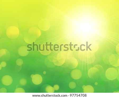 Fresh green abstract spring background with bokeh effect and sun light