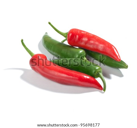 Fresh green and red chilli peppers isolated on white background