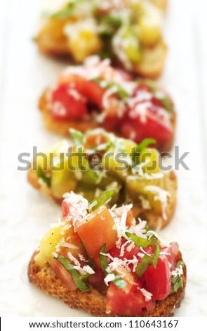 Fresh green and red heirloom tomato bruschetta