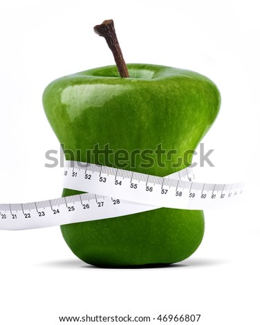 fresh green apple with measure tape over white