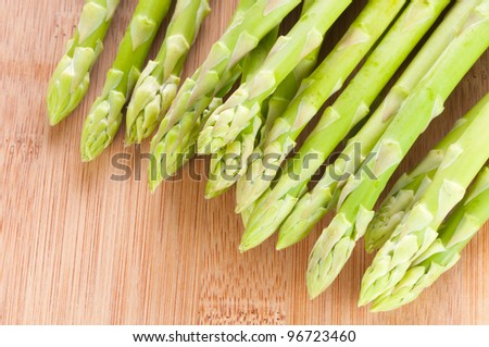 Fresh green Asparagus bundle on wooden background