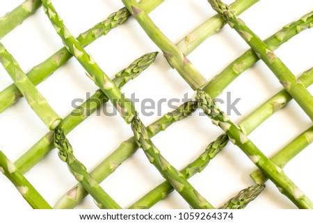 Fresh green asparagus. Lattice of fresh vegetables asparagus. Spring vegetables. Food background