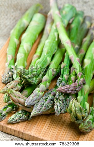 Fresh green asparagus on cutting board