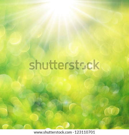 Fresh green background with bokeh bubbles and sun light. Spring or summer background