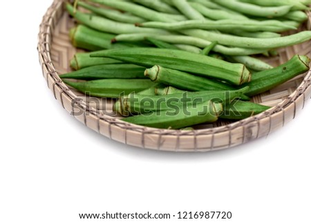 Fresh green Bendi,okra or lady fingers and green beans ready to cook, isolated in white. space for text.