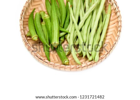 Fresh green Bendi, okra or lady fingers and green beans ready to cook, isolated in white. space for text.