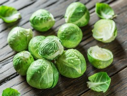 Fresh green brussel sprouts on the old wooden table.