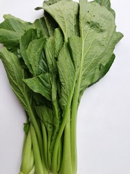 Fresh green cantonese vegetables on white background.