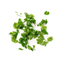 Fresh green chopped parsley leaves isolated on white background. Spicy aromatic sliced raw herbs of garden parsley. Cilantro or corriender leaves pieces top view