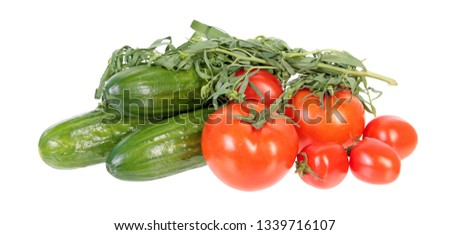 Fresh green cucumbers, red tomatoes and bundle of tarragon isolated on white background. Ingredients for vegetable salad #1339716107