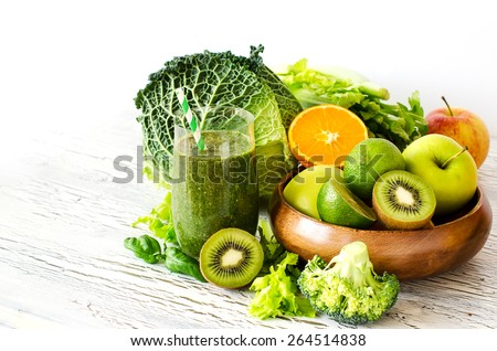 Fresh green detox vitamin  smoothie on white background for healthy snack #264514838