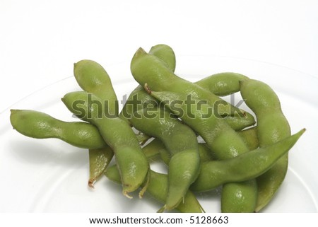fresh green edinome (soy beans with the pod) on a glass plate