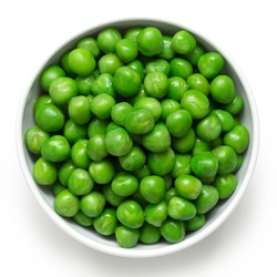 Fresh green garden peas in a white ceramic bowl isolated on white. Top view.