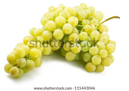 Fresh green grapes close up on the white