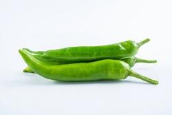 Fresh green green pepper on white background