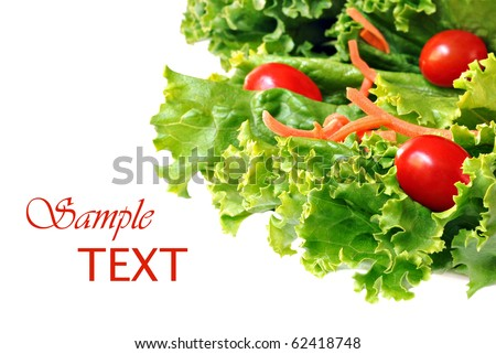 Fresh green lettuce salad with shredded carrots and grape tomatoes on white background with copy space.  Macro with shallow dof.
