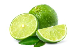Fresh green lime fruit with water droplets and cut in half sliced isolated on white background.