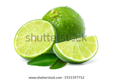 Fresh green lime fruit with water droplets and cut in half sliced isolated on white background. Foto d'archivio ©