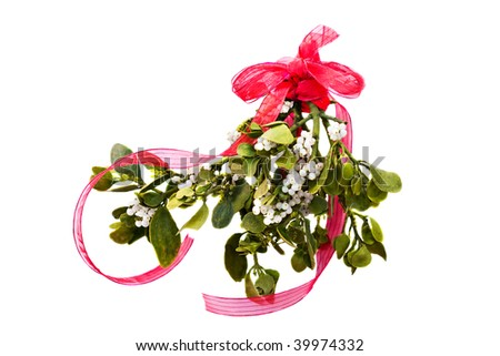 Fresh green mistletoe with a red bow and ribbon on a white background