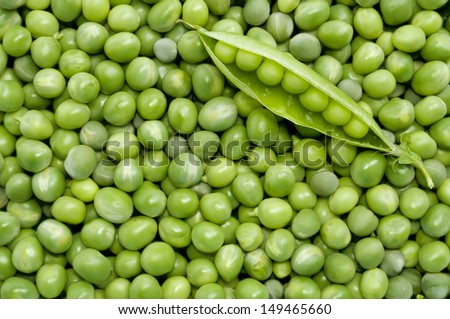 Fresh green peas background with green pea pod