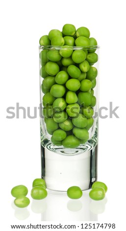 Fresh green peas in a glass isolated on white background