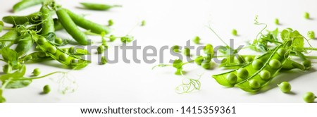 Fresh green  peas pods and  green peas with  sprouts on white wooden background. Concept of healthy eating, fresh vegetables.