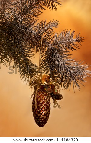 Fresh green pine branches and a gold bump