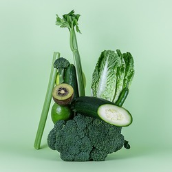 Fresh green vegetables and fruits for a healthy smoothie or alkaline diet. Equilibrium floating food balance.