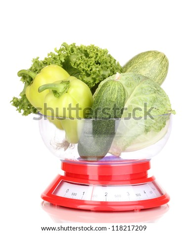 fresh green vegetables in scales isolated on white