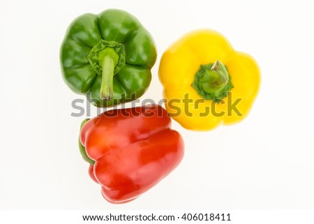 Fresh green, yellow and red bell peppers, top view, isolated on white background. #406018411