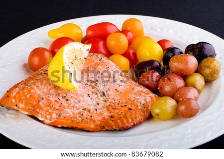 Fresh grilled salmon with cherry tomatoes and potatoes.