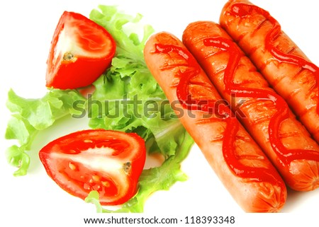 fresh grilled sausages served with tomato and ketchup