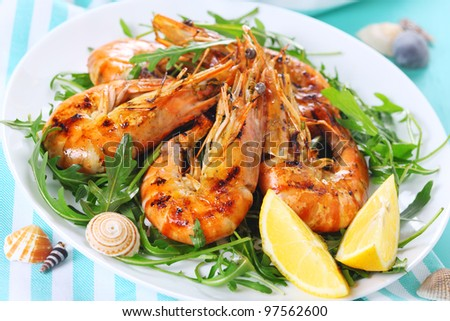 fresh grilled shrimp with Lemon on white plate - stock photo