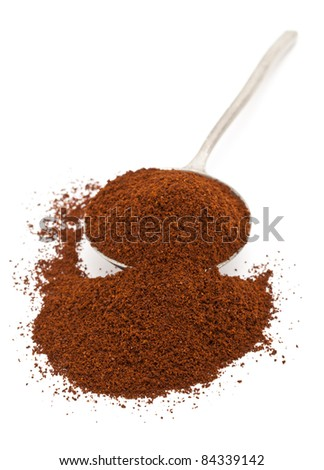 Fresh ground coffee beans in spoon isolated on white background
