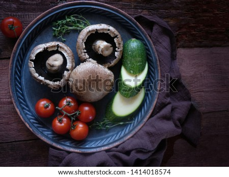Fresh grow mushrooms and fresh vegetables - fresh vegetables-zucchini,tomatoes,eggplant, onions,  on wooden rustic table viewed from above. Rustic. ingredients for vegan, Keto, Paleo dieta.  #1414018574