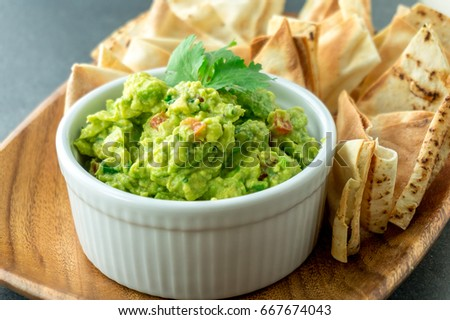 Fresh guacamole bowl. Guacamole is a avocado based dip, traditionally a mexican (Aztecs) dish. Healthy and easy to make at home with a few simple ingredients. Excellent as party food or at bars.