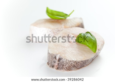 Fresh hake slice isolated over white background
