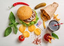 Fresh hamburger with French fries on white background