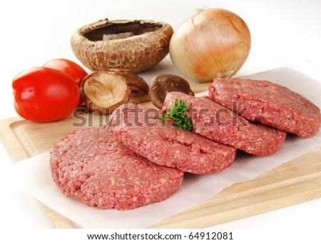 Fresh hamburger with tomato, portabello and shiitake mushrooms