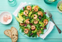 fresh healthy avocado and shrimps salad. Top view