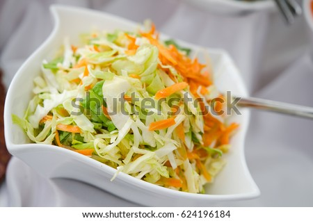 Fresh healthy salad - cabbage, carrot and olive oil