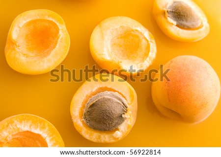 Fresh healthy sliced and whole apricots representing juice concept.