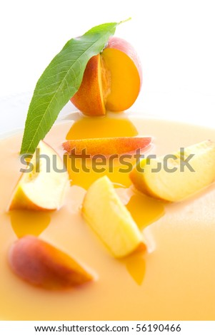 Fresh healthy sliced and whole nectarines representing juice concept.